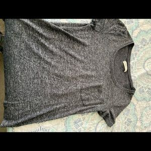 Grey textured t shirt with front pocket.